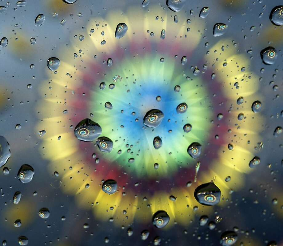 Foul-weather fair: The Ferris wheel of the Garrard County Fair is reflected in raindrops on the windshield of a 