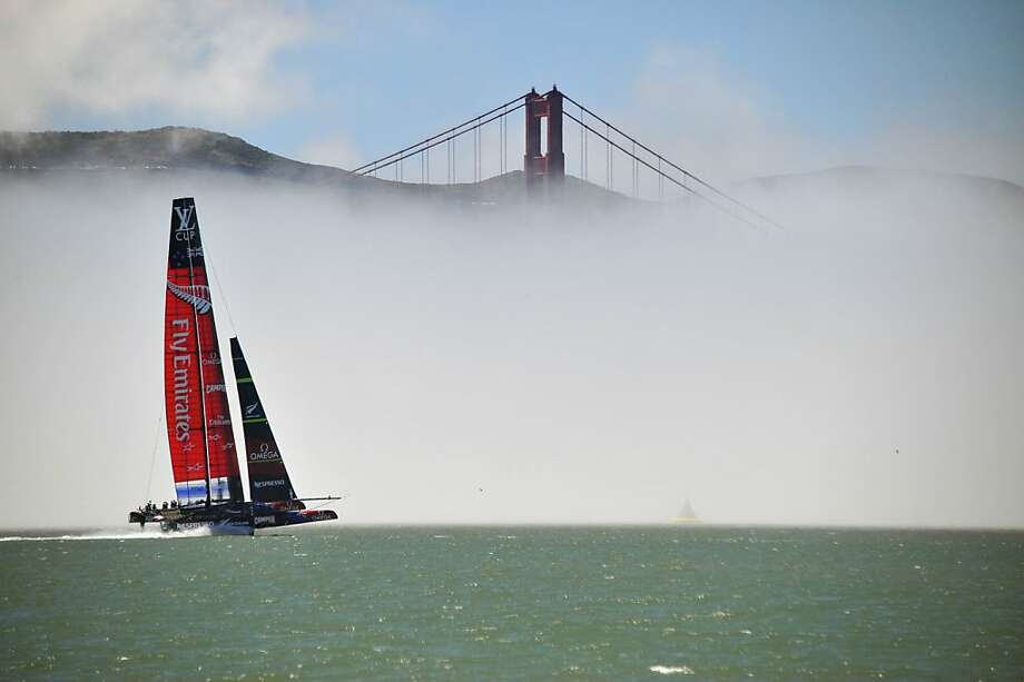 Fog cat:Team Emirates sails its AC-72 Racing Yacht by the Golden Gate Bridge in preparation for the   upcoming America's Cup competition on San Francisco Bay. Photo: Josh Edelson, AFP/Getty Images