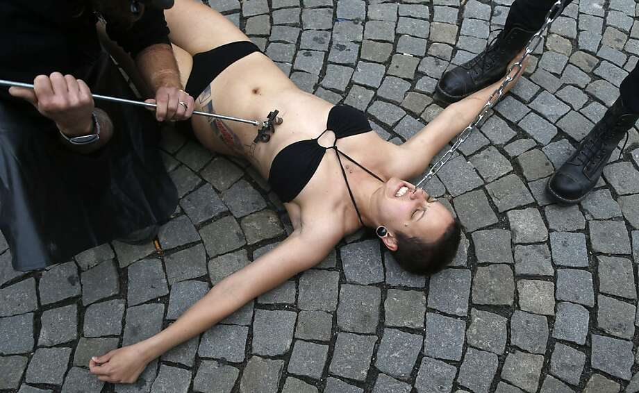 "Etch-a-Czech: An animal rights activist is branded with the number ""269"" as the 269Life movement comes to Prague. The movement encourages human branding to raise awareness of the plight of animals. The name ""269Life"" is derived from the number branded on a calf that activists encountered at an Israeli dairy farm last year. Photo: Petr David Josek, Associated Press"