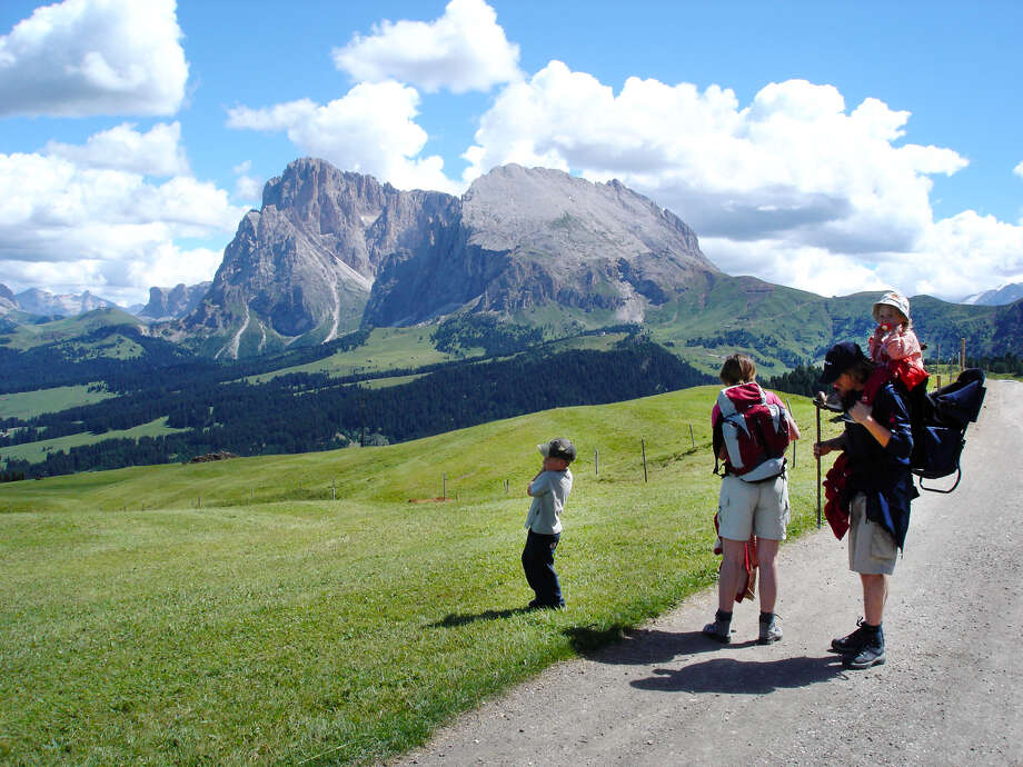 A family gets ready for a hike in Italy's Alpe di Siusi — the largest alpine meadow in Europe. Photo: Rick Steves, Ricksteves.com