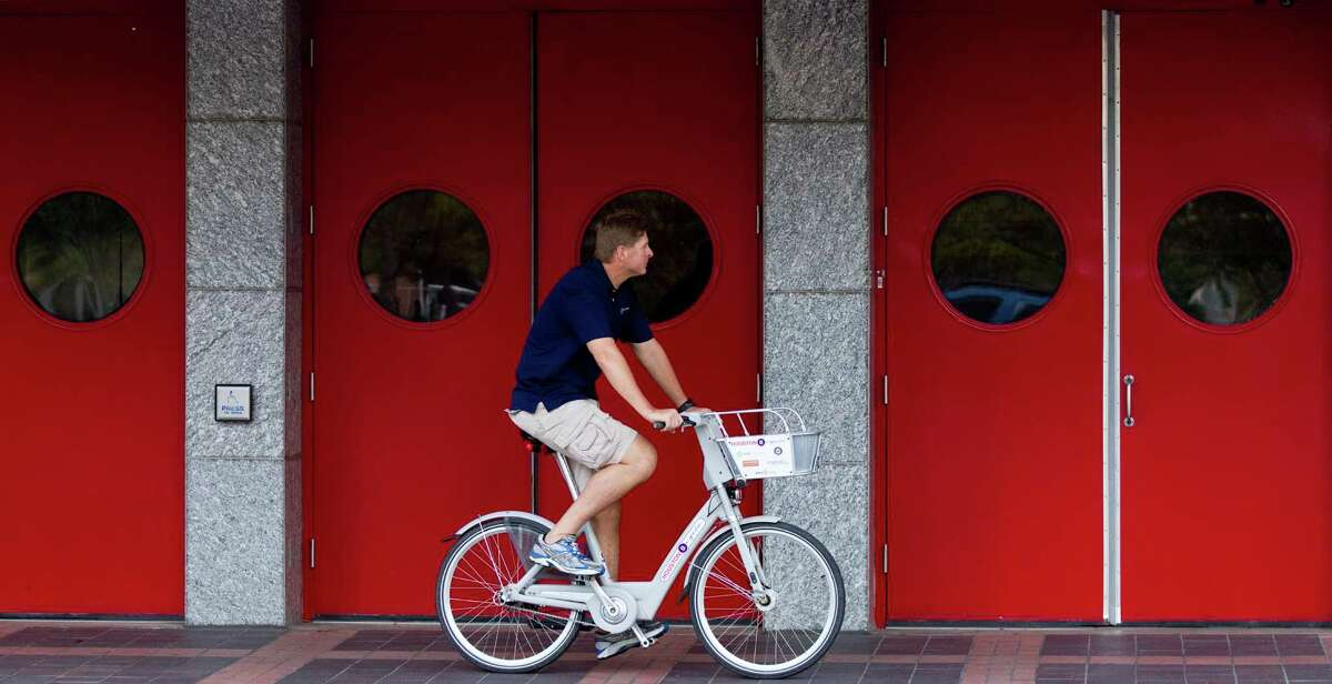 Will Rub, director of Houston Bike Share, rides downtown on one of the B-cycle rental bicycles.