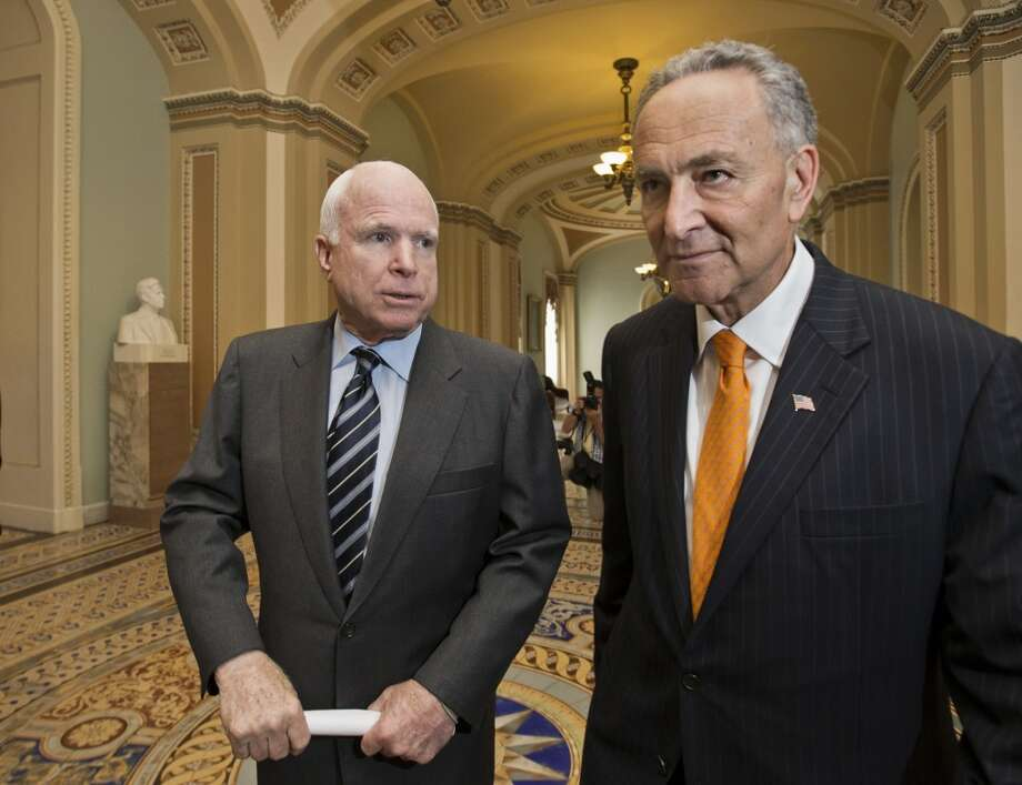 "Sen. John McCain, R-Ariz., left, and Sen. Charles Schumer, D-N.Y., right, two of the authors of the immigration reform bill crafted by the Senate's bipartisan ""Gang of Eight,"" confer on Capitol Hill in Washington, Thursday, June 27, 2013, prior to the final vote. The historic legislation would dramatically remake the U.S. immigration system and require a tough new focus on border security.  (AP Photo/J. Scott Applewhite) Photo: J. Scott Applewhite, Associated Press"