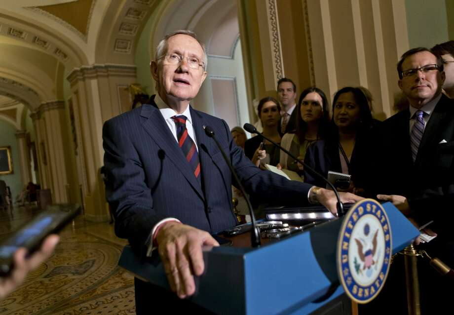 Senate Majority Leader Harry Reid of Nev., updates reporters on the pace of the immigration reform bill following a Democratic strategy session, Tuesday, June 25, 2013, on Capitol Hill in Washington.  (AP Photo/J. Scott Applewhite) Photo: J. Scott Applewhite, Associated Press