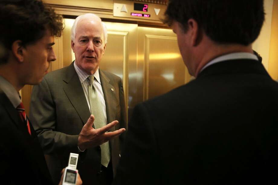 WASHINGTON, DC - JUNE 24:  U.S. Senate Minority Whip Sen. John Cornyn (R-TX) speaks to members of the media after a vote on the Senate floor June 24, 2013 on Capitol Hill in Washington, DC. The Senate had passed a cloture vote to end the debate on immigration reform which has paved the way for a vote on the final passage of the legislation.  (Photo by Alex Wong/Getty Images) Photo: Alex Wong, Getty Images