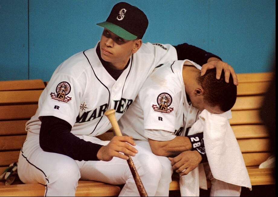 Alex Rodriguez comforts Joey Cora after the Mariners lost the ALCS to the Cleveland Indians on Oct. 17, 1995. Photo: Mike Urban, Seattle P-I Archive
