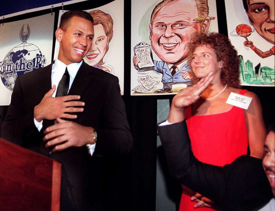 "Seattle Post-Intelligencer Sports Stars of the Year Alex Rodriguez and Michelle Akers are seen after receiving their awards from P-I Publisher J.D. Alexander on Jan. 21, 1997. Rodriguez had just brought down the house by saying, ""First of all I want to thank Jim Street and Bob Finnegan for not voting."" Photo: PAUL JOSEPH BROWN, Seattle P-I Archive"