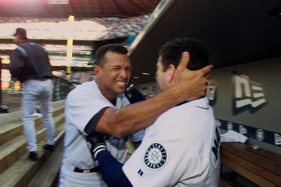 Seattle Mariners Alex Rodgriguez (C) celebrates his teams 2-1 victory over the Chicago White Sox with teammate Edgar Martinez (R) after winning the American League 2000 Division Series in Seattle 06 October, 2000. Photo: Dan Levine, AFP/Getty Images / AFP