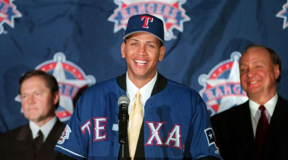 12 Dec 2000:  Newly signed Texas Ranger Alex Rodriguez, center, is introduced to the media by club owner Tom Hicks, right, and Rodriguez' agent Scott Boras during a press conference at The Ballpark in Arlington, Texas, on Dec. 12, 2000. Photo: Gary Barber/Allsport, Getty Images / Getty Images North America