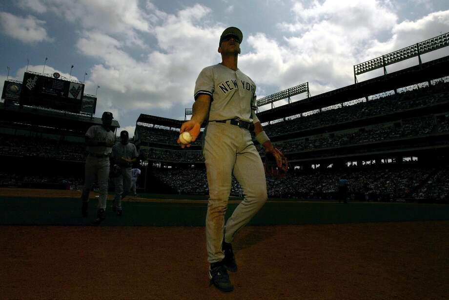 Alex Rodriguez #13 of the New York Yankees throws a baseball into the stands during play against the Texas Rangers at Ameriquest Field in Arlington on May 23, 2004, in Arlington, Texas. Photo: Ronald Martinez, Getty Images / 2004 Getty Images