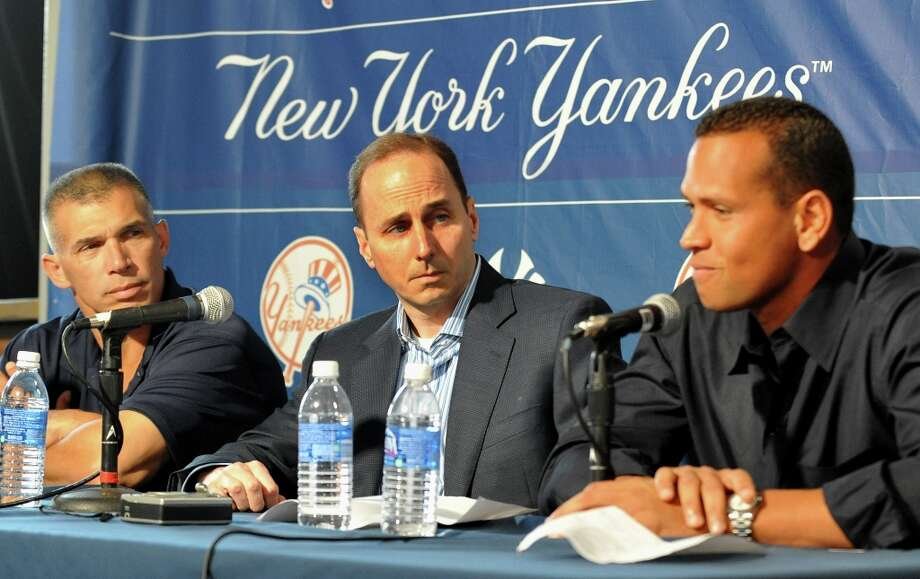 "Alex Rodriguez of the New York Yankees talks during a press conference as Manager Joe Girardi (L) and General Manager Brian Cashman (C) listen February 17, 2008, at the George M. Steinbrenner Field in Tampa, Florida. The Yankees third baseman admitted to taking a substance known as ""boli"" acquired with his cousin in the Dominican Republic in 2001. Photo: Al Messerschmidt, Getty Images / 2009 Getty Images"
