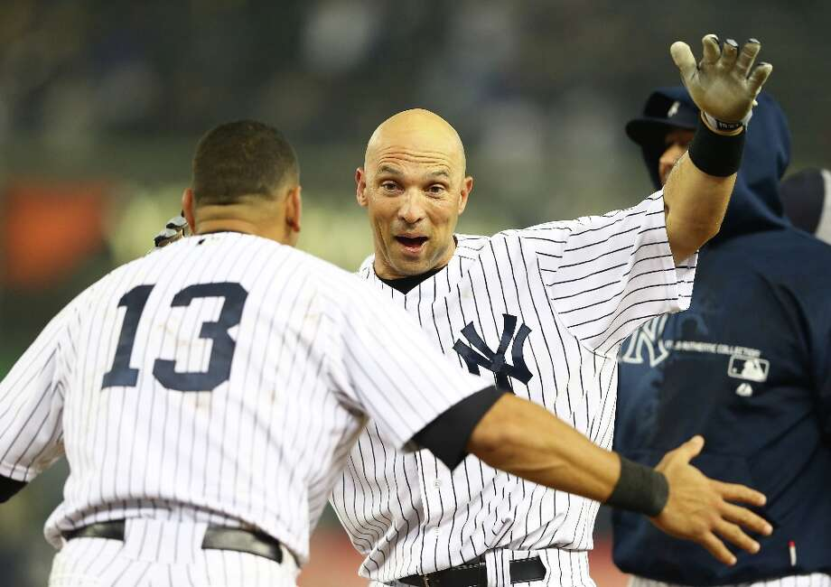 Raul Ibanez of the New York Yankees celebrates with Alex Rodriguez #13 after hitting a walk-off single against the Boston Red Sox in the 12th inning to win the game 4-3  on October 2, 2012, at Yankee Stadium in the Bronx borough of New York City. Photo: Al Bello, Getty Images / 2012 Getty Images