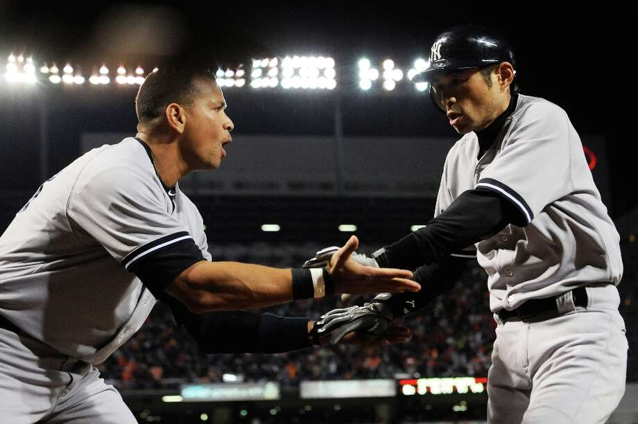 Ichiro Suzuki, right, of the New York Yankees is congratulated by Alex Rodriguez after scoring a run on an RBI double hit by Robinson Cano in the top of the first inning during Game Two of the American League Division Series against the Baltimore Orioles at Oriole Park at Camden Yards on October 8, 2012 in Baltimore, Maryland. Photo: Patrick McDermott, Getty Images / 2012 Getty Images