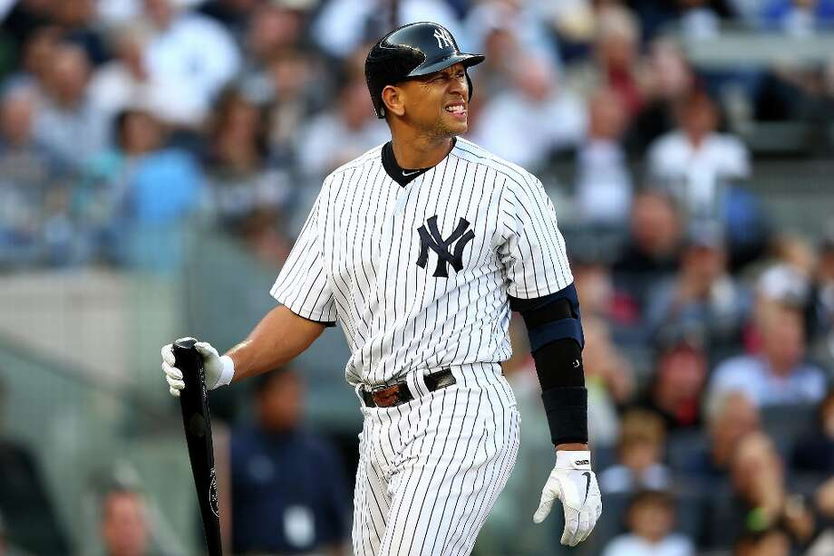 Alex Rodriguez of the New York Yankees reacts as he walks back to the dugout after he struck out in the bottom of the second inning against the Detroit Tigers during Game Two of the American League Championship Series at Yankee Stadium on October 14, 2012 in the Bronx borough of New York City. Photo: Elsa, Getty Images / 2012 Getty Images