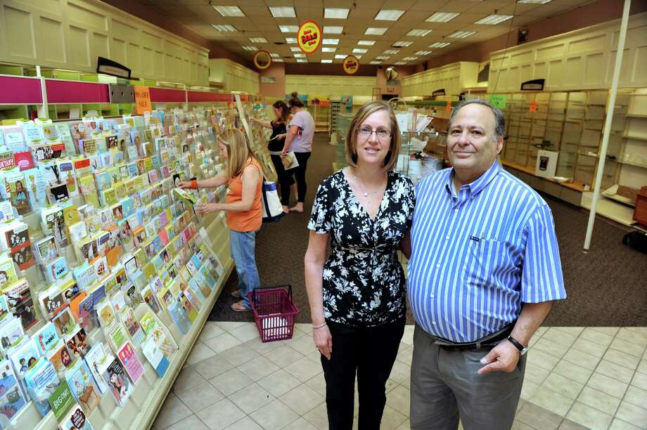 Joy Evagash, left, and brother-in-law Barry Tannenbaum, are photographed in their store Thursday, June 27, 2013. Joy's Hallmark in Brookfield, Conn. is closing after 40 years in business, with the retirement of owner Barry Tannenbaum. Photo: Carol Kaliff / The News-Times