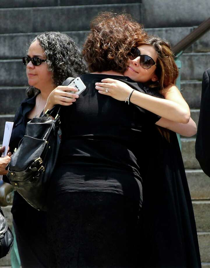 "Actress Jamie Lynn Sigler, right, is embraced as she leaves the Cathedral Church of Saint John the Divine after the funeral service for James Gandolfini, Thursday, June 27, 2013 in New York.  Gandolfini, who played Tony Soprano in the HBO show ""The Sopranos"", died while vacationing in Italy last week. Photo: Mary Altaffer"