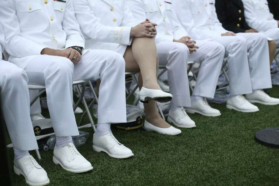U.S. Naval Academy cadets attend their commencement ceremony in May. Military women still face a culture that tolerates but does not necessarily accept them. Photo: Doug Mills, New York Times