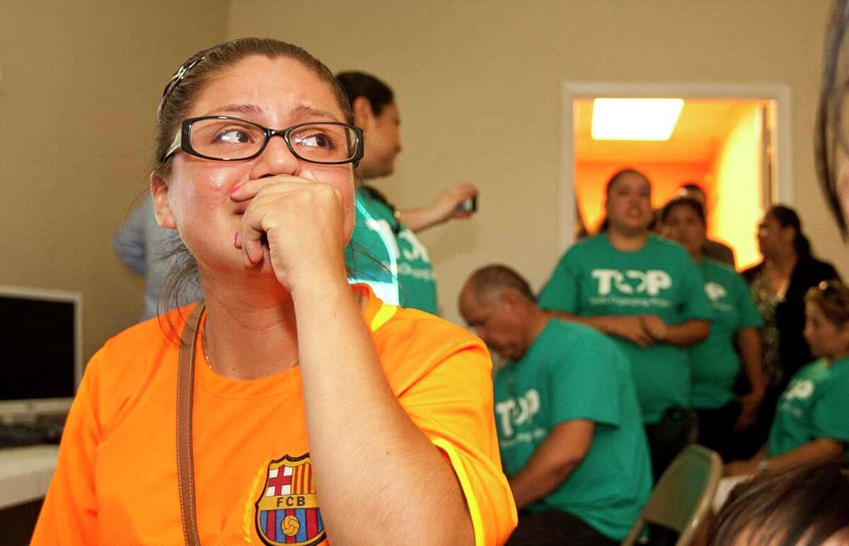 Yesenia Ramirez becomes emotional as the thinks about her family in Mexico, who she hasn't seen for 13-years, after the newest immigration reform bill is passed through the U.S. Senate in the FIEL, immigration activist office in Houston. ( Nick de la Torre / Houston Chronicle )