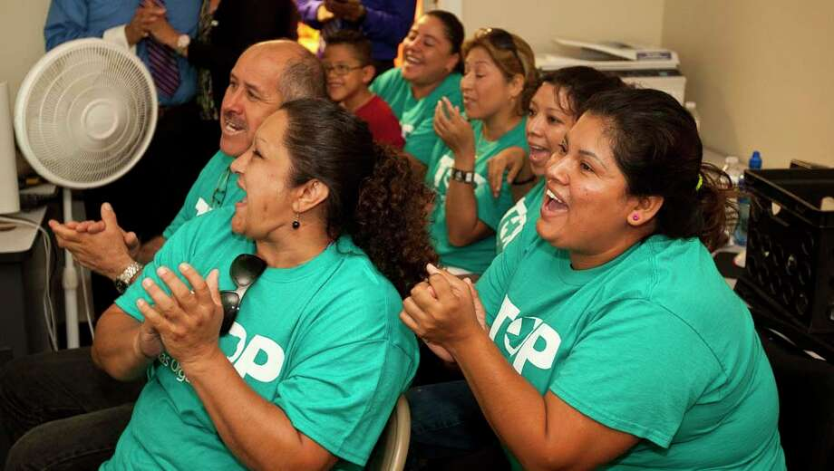 Maris Galindo, left, and Zulema Perez, cheer, after the newest immigration reform bill is passed through the U.S. Senate in the FIEL, immigration activist office in Houston. Both women are immigrants hoping to stay in the U.S. as citizens. ( Nick de la Torre / Houston Chronicle ) Photo: Nick De La Torre, Houston Chronicle / © 2013  Houston Chronicle