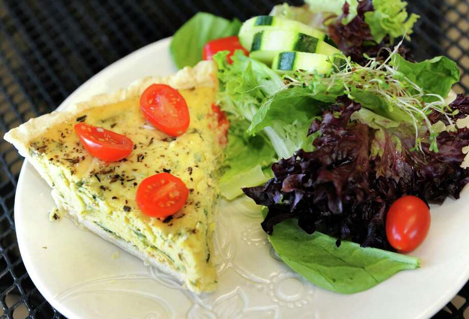 Pika's Farmtable feta and cherry tomato quiche with a side salad on Friday, June 21, 2013, at The Local Flavor Cafe in Watervliet, N.Y. (Cindy Schultz / Times Union) Photo: Cindy Schultz / 00022900A