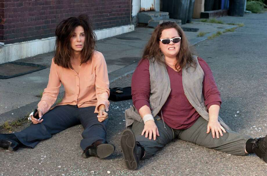 "This film publicity image released by 20th Century Fox shows Sandra Bullock as FBI Special Agent Sarah Ashburn, left, and Melissa McCarthy as  Boston Detective Shannon Mullins in a scene from ""The Heat."" (AP Photo/20th Century Fox, Gemma La Mana) Photo: Gemma La Mana / 20th Century Fox"