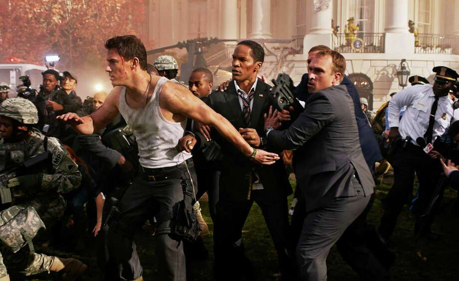 "FILE - In this undated publicity photo provided by Sony Pictures Entertainment, Channing Tatum, left, and Jamie Foxx, center, star in Columbia Pictures' ""White House Down,"" directed by Roland Emmerich. (AP Photo/Sony Pictures Entertainment, Reiner Bajo) ORG XMIT: CAPH988 Photo: Reiner Bajo / Sony Pictures Entertainment"