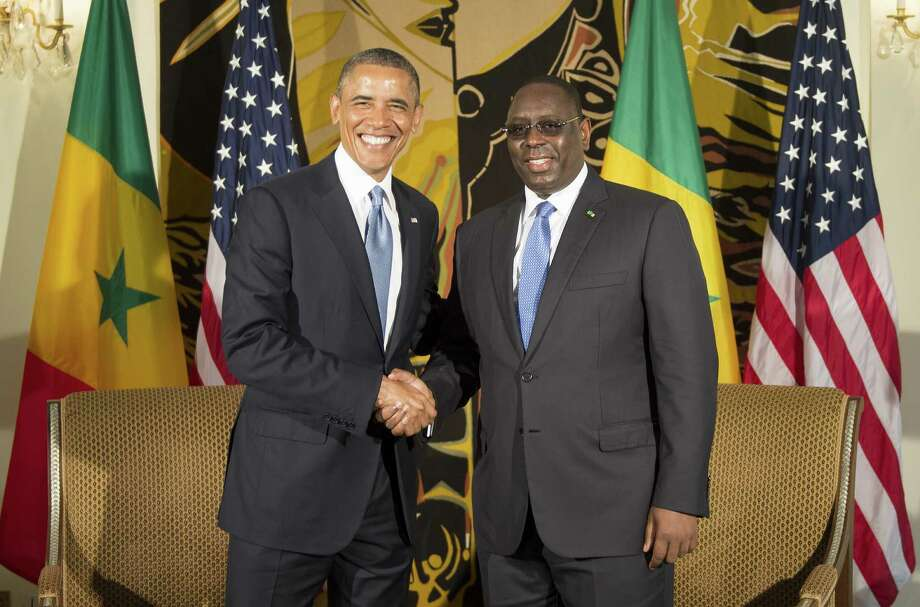 US President Barack Obama (L) shakes hands with Senegal President Macky Sall June 27, 2013 during a bilateral meeting at the presidential palace in Dakar. Obama arrived late on June 26 in Dakar to launch a three-nation trip designed to fulfil neglected expectations for his presidency on a continent where he has deep ancestral roots.  AFP PHOTO/JIM  WATSONJIM WATSON/AFP/Getty Images Photo: JIM WATSON, Staff / AFP ImageForum
