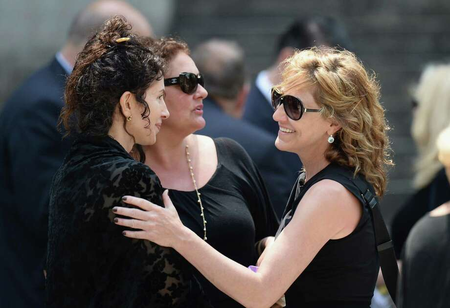 Actors Aida Turturro (2nd from L) and Edie Falco attend the funeral for actor James Gandolfini at The Cathedral Church of St. John the Divine on June 27, 2013 in New York City. Gandolfini passed away on June 19, 2013 while vacationing in Rome, Italy. Photo: Mike Coppola, Getty Images / 2013 Getty Images