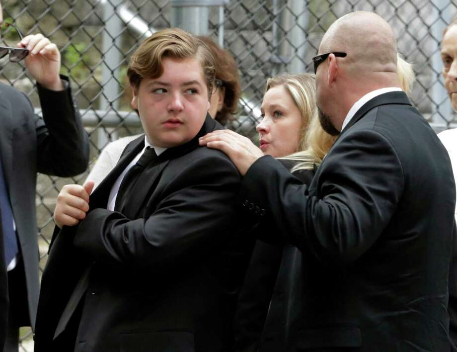 """Michael Gandolfini, left, son of James Gandolfini, arrives for the funeral service of his father, star of """"The Sopranos,"""" in New York's the Cathedral Church of Saint John the Divine,  Thursday, June 27, 2013. The 51-year-old actor died of a heart attack last week while vacationing in Italy with his son. Photo: Richard Drew, Associated Press / AP"""
