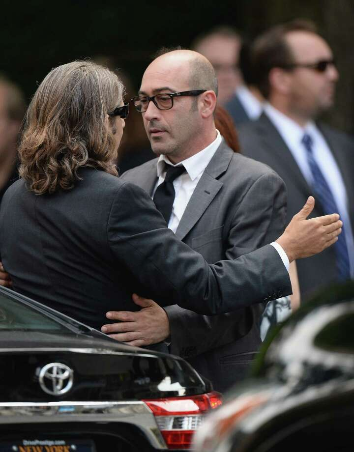 Actors Michael Imperioli (L) and John Ventimiglia embrace at the funeral for Actor James Gandolfini at The Cathedral Church of St. John the Divine on June 27, 2013 in New York City. Gandolfini passed away on June 19, 2013 while vacationing in Rome, Italy. Photo: Mike Coppola, Getty Images / 2013 Getty Images