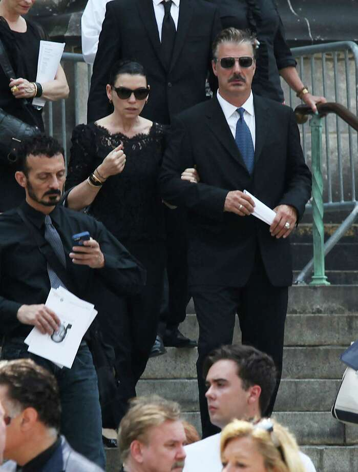 Chris Noth and Julianna Margulies leave the funeral of actor James Gandolfini at The Cathedral Church of St. John the Divine on June 27, 2013 in New York City. Gandolfini passed away on June 19, 2013 while vacationing in Rome, Italy. Photo: Rob Kim, Getty Images / 2013 Getty Images