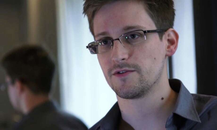 "(FILES) This still frame grab recorded on June 6, 2013 and released to AFP on June 10, 2013 shows Edward Snowden, who has been working at the National Security Agency for the past four years, speaking during an interview with The Guardian newspaper at an undisclosed location in Hong Kong.  In the buildup to his 30th birthday last week, US fugitive Edward Snowden came to the sudden realisation over a dinner of pizza and Pepsi that Hong Kong may not be such a welcoming refuge, his legal advisor says.       AFP PHOTO / THE GUARDIAN / FILES     ---EDITORS NOTE--- RESTRICTED TO EDITORIAL USE - MANDATORY CREDIT ""AFP PHOTO / THE GUARDIAN"" - NO MARKETING NO ADVERTISING CAMPAIGNS - DISTRIBUTED AS A SERVICE TO CLIENTS - NO ARCHIVESThe Guardian/AFP/Getty Images Photo: THE GUARDIAN, Handout / AFP"