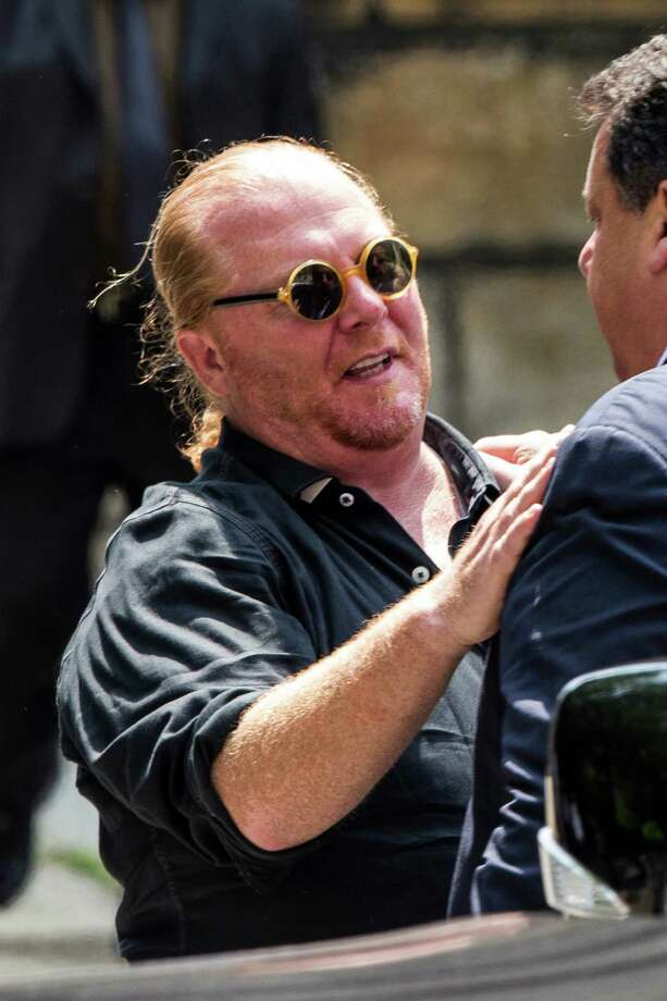 Chef Mario Batali leaves after attending the funeral for Actor James Gandolfini at The Cathedral Church of St. John the Divine on June 27, 2013 in New York City. Gandolfini passed away on June 19, 2013 while vacationing in Rome, Italy. Photo: Andrew Burton, Getty Images / 2013 Getty Images