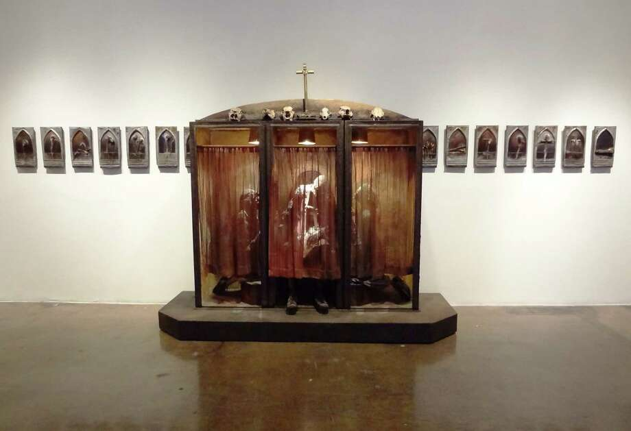 "Houston artist Sharon Kopriva's ""Confessional"" and ""Fourteen Stations of the Cross"" are part of the ""Texas Tough"" exhibit at Blue Star Contemporary Art Museum. Photo: Photos By Steve Bennett / San Antonio Express-News"