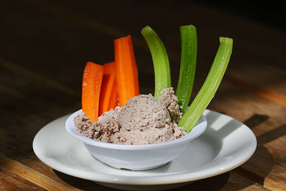 Raw Pecan Hummus, made with pecans instead of garbanzo beans, is served at Green Vegetarian cuisine. Photo: Jerry Lara / San Antonio Express-News