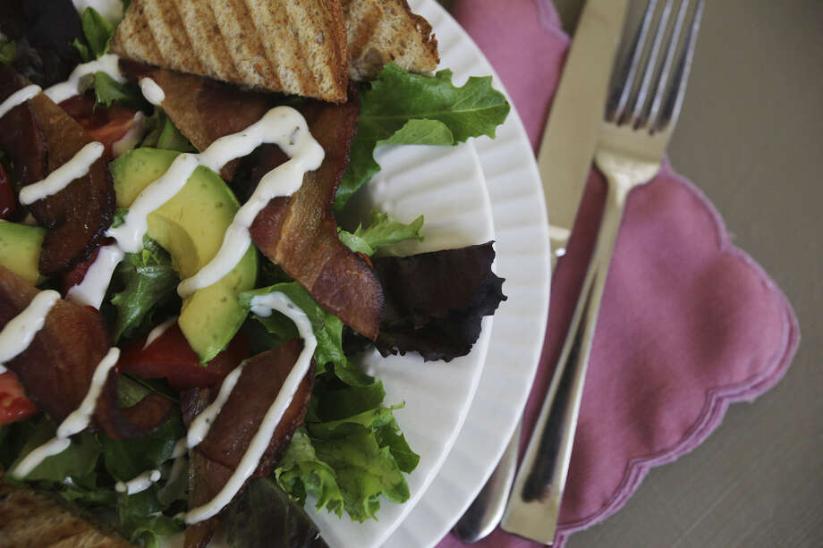 The BLT Bowl at Avocado Café features spring greens with bacon, avocado and a housemade ranch dressing. Photo: Photos By Abbey Oldham / San Antonio Express-News
