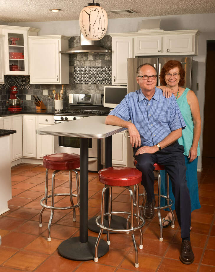 Larry and Judy Weiss enjoy entertaining in the kitchen of their Braun Station home. Photo: Photos By Robin Jerstad / For The Express-News