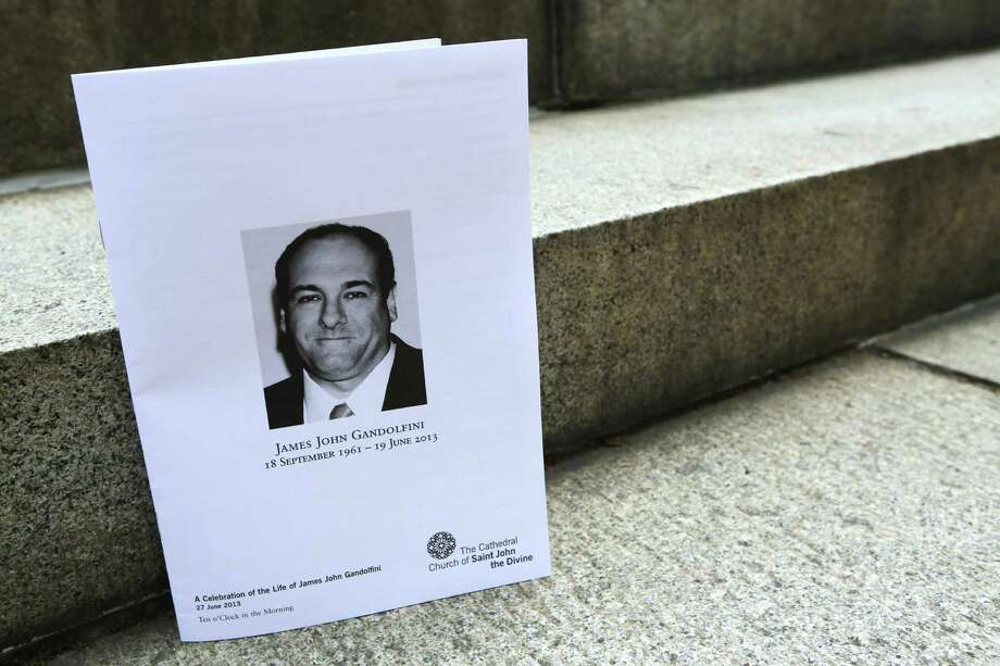 "The program for James Gandolfini's funeral is seen outside the Cathedral Church of Saint John the Divine after his funeral service, Thursday, June 27, 2013 in New York.  Gandolfini, who played Tony Soprano in the HBO show ""The Sopranos"", died while vacationing in Italy last week. Photo: Mary Altaffer, Associated Press / AP"