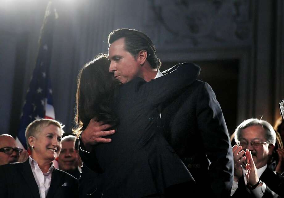 "Same-sex marriage pioneer Lt. Gov. Gavin Newsom hugs activist Kate Kendell. Concerns are ""legitimate,"" he agreed. Photo: Lea Suzuki, The Chronicle"