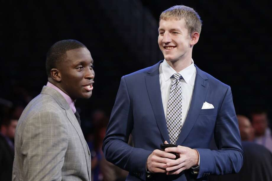 Indiana players Victor Oladipo, and Cody Zeller chat before the NBA draft.