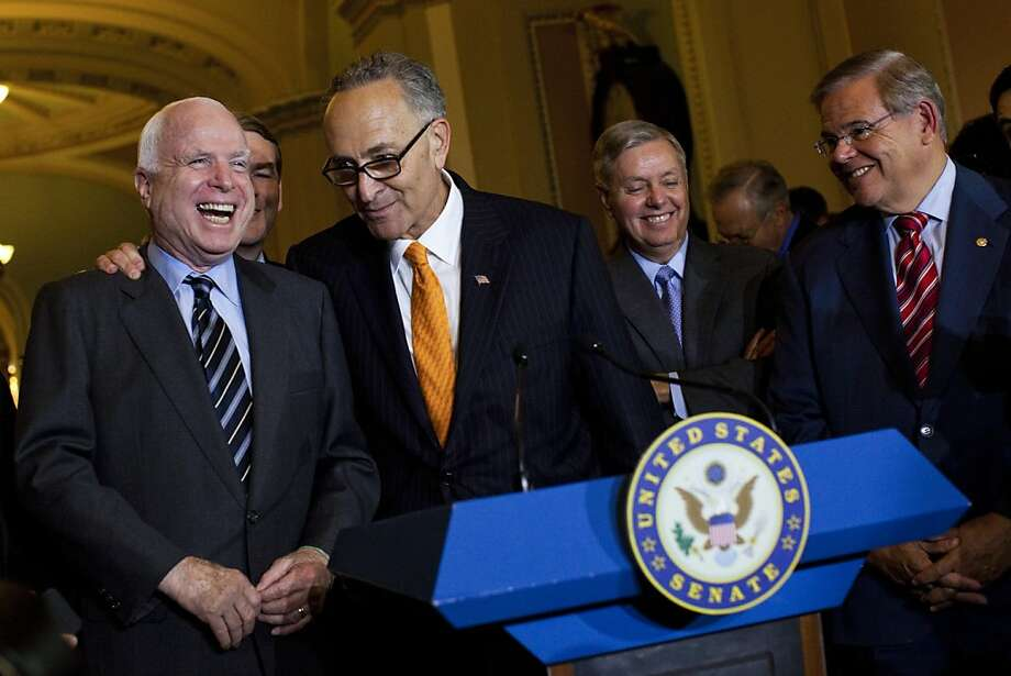 John McCain (left), R-Ariz., Chuck Schumer, D-N.Y., Lindsey Graham, R-S.C., and Bob Menendez, D-N.J., were among the Gang of Eight senators who wrote the immigration bill. Photo: Christopher Gregory, New York Times