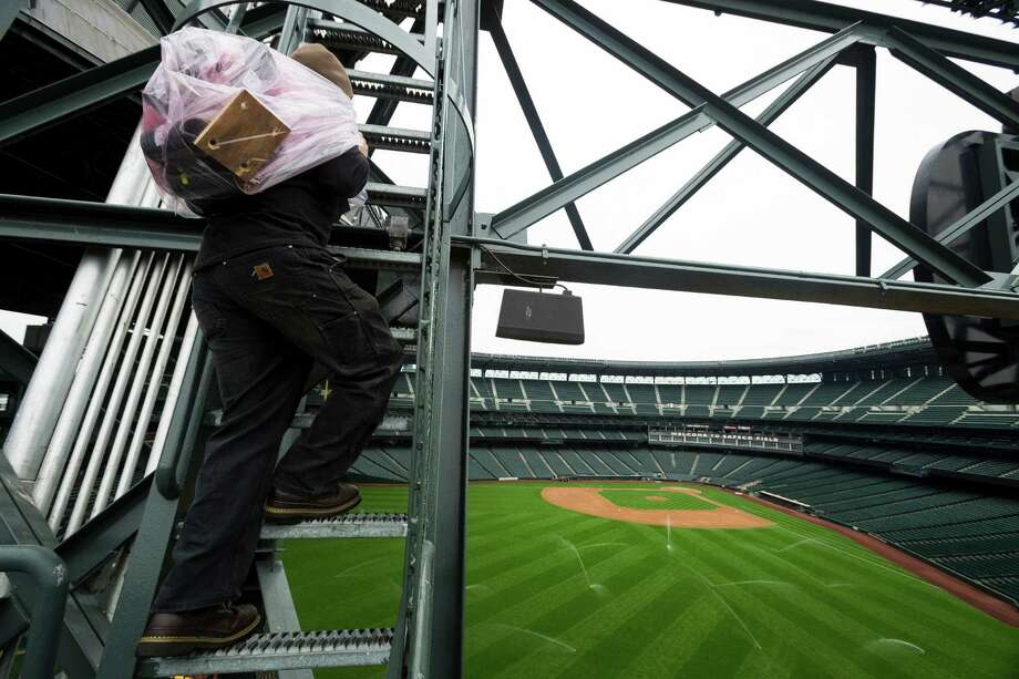 A 10-person crew from Pyro Spectaculars worked to set up and wire pyrotechnic charges for a first-ever Mariners post-game fireworks show Thursday, June 27, 2013, at Safeco Field in Seattle. Between 1,200-1,500 charges will be set up for Friday's 15 minute display set to music. The program will still take place even if there is light rain. Lighting, thunder, heavy rain and high winds would prompt cancellation of the show. Photo: JORDAN STEAD, SEATTLEPI.COM / SEATTLEPI.COM