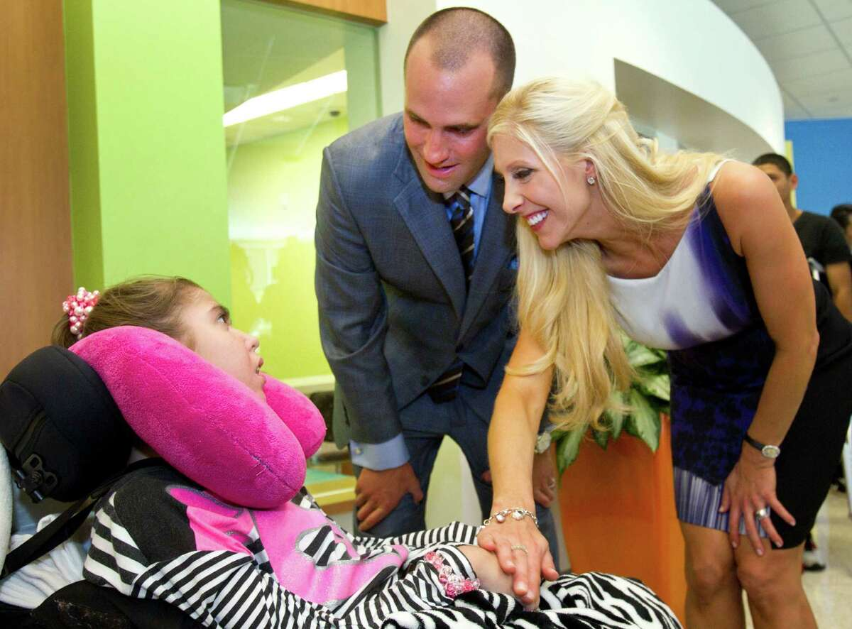 Houston Texans quarterback Matt Schaub and his wife, Laurie, greet Lauren Kainer, 17, during a visit to Texas Children's Hospital West Campus Thursday, June 27, 2013, in Houston. The Schaubs announced during a news conference a $250,000 donation for emergency center expansion. The donation comes through the Gr8Hope Foundation.