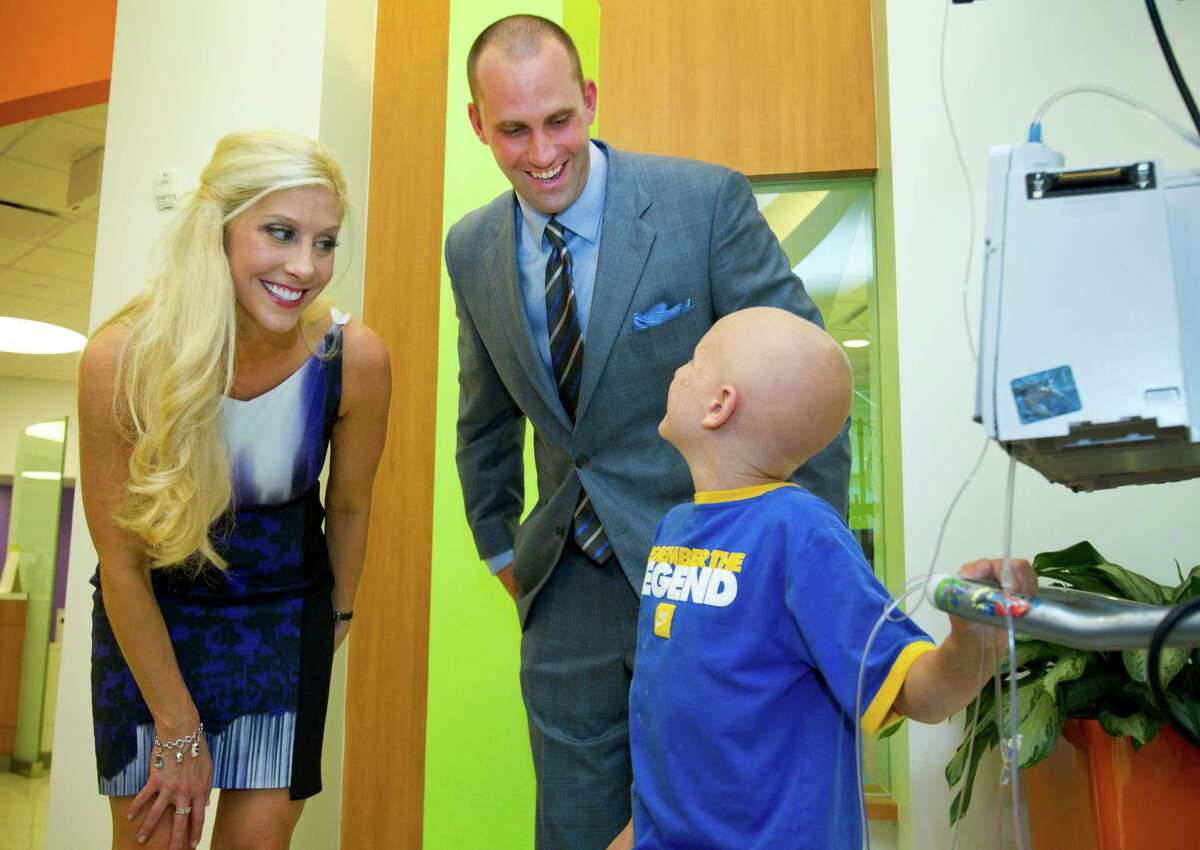 Laurie and Matt Schaub greet Jonathan Davis, 9, during a visit to Texas Children's Hospital West Campus Thursday, June 27, 2013, in Houston. The Schaubs announced during a news conference a $250,000 donation for emergency center expansion. The donation comes through the Gr8Hope Foundation.