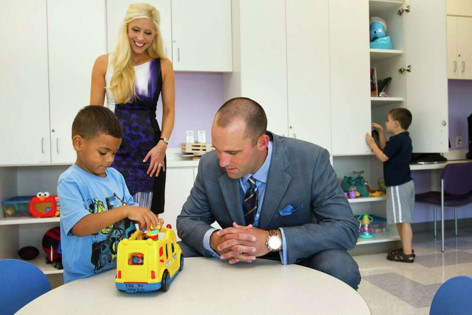 Houston Texans quarterback Matt Schaub and his wife, Laurie, visit with Jaiden Horn in a playroom at Texas Children's Hospital West Campus Thursday, June 27, 2013, in Houston. The Schaubs announced during a news conference a $250,000 donation for emergency center expansion. The donation comes through the Gr8Hope Foundation. Photo: Brett Coomer, Houston Chronicle / © 2013 Houston Chronicle