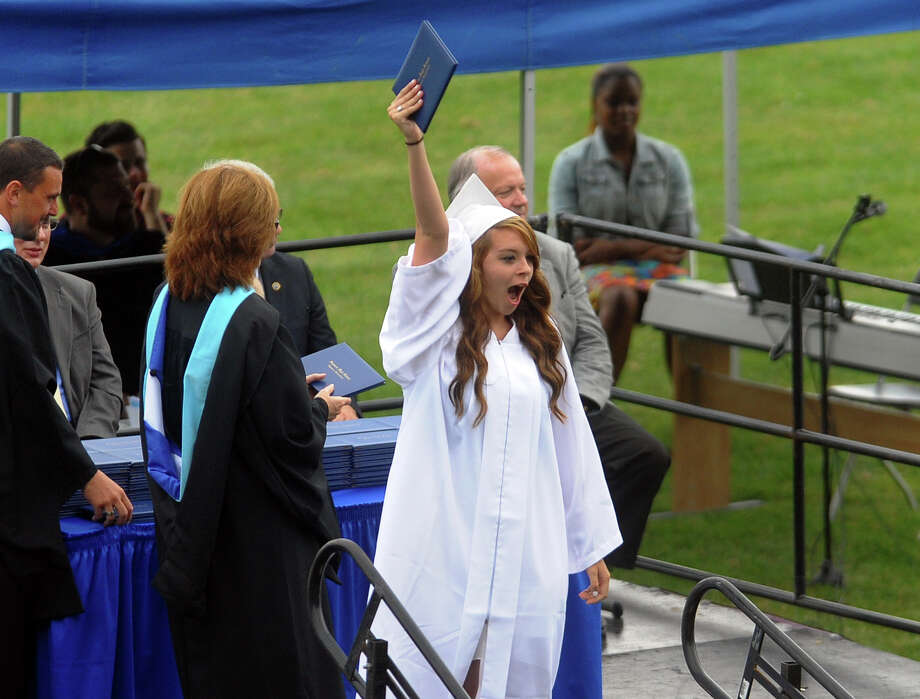 Graduate Courtney Hylwa lets out a cheer as she holds her diploma high in the air during Seymour High School's 126th Annual Commencement in Seymour, Conn. on Thursday June 27, 2013. Photo: Christian Abraham / Connecticut Post