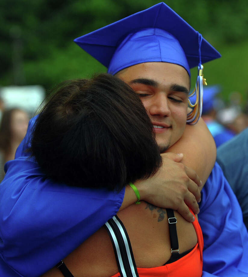 Graduate Elliott Santana gets a hug from his grandmother Donna Santana after Seymour High School's 126th Annual Commencement in Seymour, Conn. on Thursday June 27, 2013. Photo: Christian Abraham / Connecticut Post
