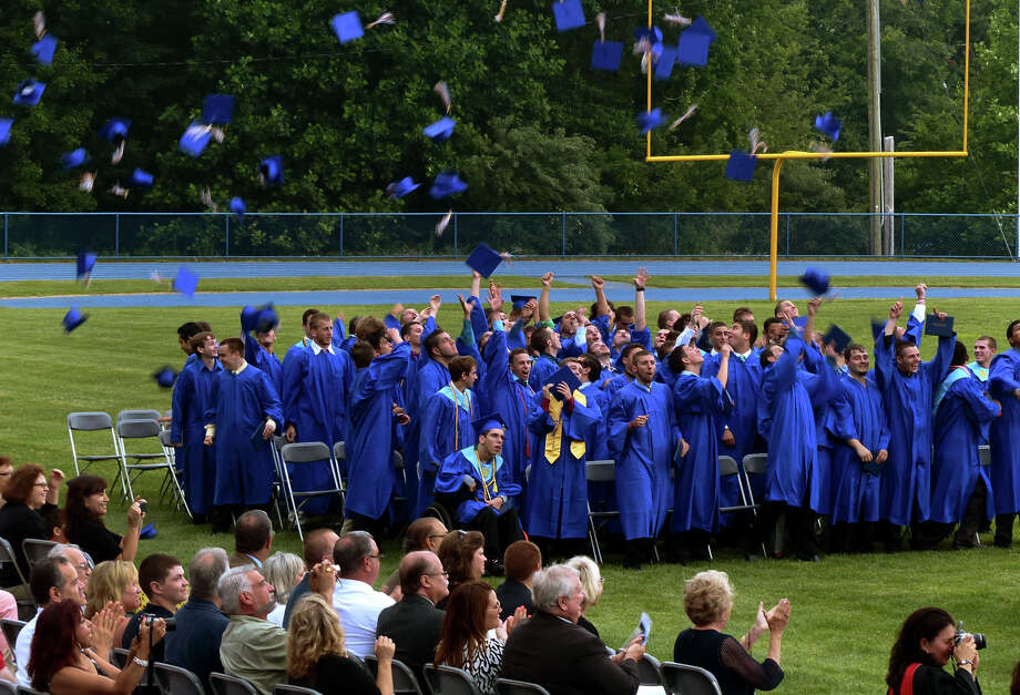 Seymour High School graduates toss their caps into the air after completing the school's 126th Annual Commencement in Seymour, Conn. on Thursday June 27, 2013. Photo: Christian Abraham / Connecticut Post