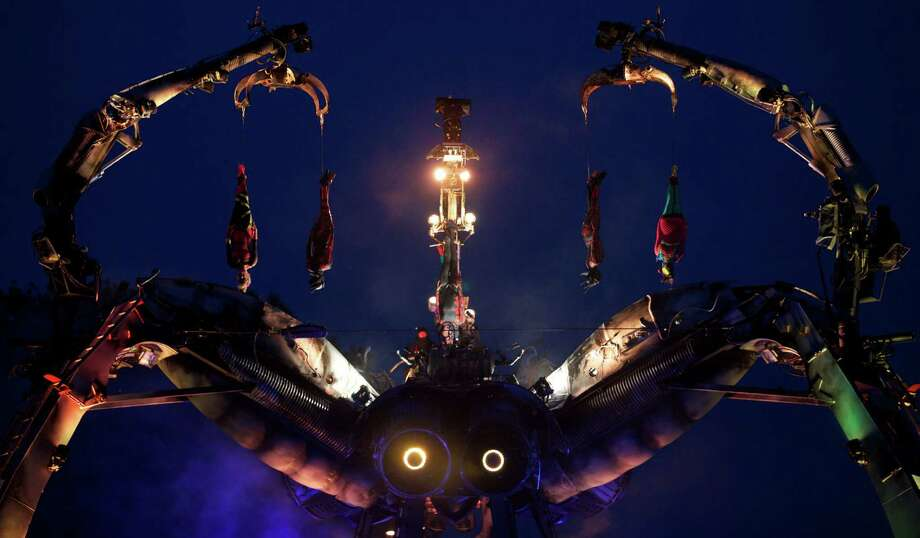 The Arcadia giant metal spider and dancers perform to music on the second day of the Glastonbury Festival of Contemporary Performing Arts near Glastonbury, southwest England, on June 27, 2013. The festival attracts 170,000 party-goers to the dairy farm in Somerset, and this year's tickets sold out within two hours of going on sale. The Rolling Stones will perform at the festival for the first time, headlining on Saturday night. Photo: ANDREW COWIE, AFP/Getty Images / AFP