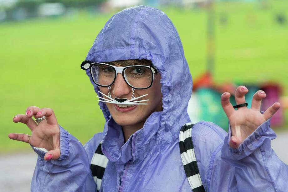 A festival goer enjoys the atmosphere as rain falls during day 1 of the 2013 Glastonbury Festival at Worthy Farm on June 27, 2013 in Glastonbury, England. Photo: Ian Gavan, Getty Images / 2013 Getty Images