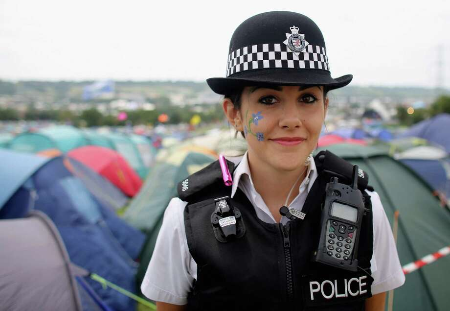 Special constable Sandie Davies, poses for a photograph at  the Glastonbury Festival site at Worthy Farm, Pilton on June 27, 2013 near Glastonbury, England.  Asked what the Glastonbury Festival meant to her, the 20-year-old from said,'Meeting new people and a great chance to engage with the community'. Gates opened on Wednesday at the Somerset diary farm that will be playing host to one of the largest music festivals in the world and this year features headline acts Artic Monkeys, Mumford and Sons and the Rolling Stones. Tickets to the event which is now in its 43rd year sold out in minutes and that was before any of the headline acts had been confirmed. The festival, which started in 1970 when several hundred hippies paid 1 GBP to watch Marc Bolan, now attracts more than 175,000 people over five days. Photo: Matt Cardy, Getty Images / 2013 Getty Images